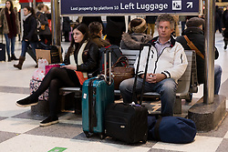 © Licensed to London News Pictures. 22/12/2015. London, UK. People with suitcases and bags wait for a train at Liverpool Street station. Today is the start of the annual festive Christmas getaway, which combined with last minute shopping and regular commuting is expected to lead to packed trains and congested roads across the country. Photo credit : Vickie Flores/LNP