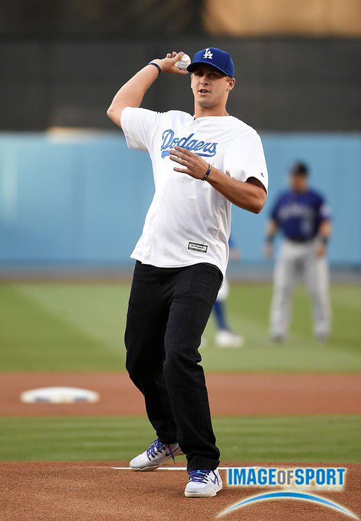 Jun 6, 2016; Los Angeles, CA, USA; Los Angeles Rams quarterback Jared Goff throws the ceremonial first pitch before a MLB game between the Colorado Rockies and the Los Angeles Dodgers at Dodger Stadium.