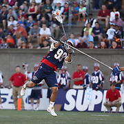 Paul Rabil #99 of the Boston Cannons jumps as he takes a shot during the game at Harvard Stadium on May 17, 2014 in Boston, Massachuttes. (Photo by Elan Kawesch)