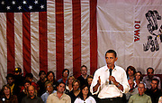 Senator Barack Obama (D-IL) answers questions firmly during an October town hall meeting in Newton, Iowa in a packed gymnasium.