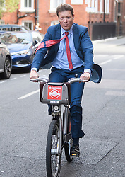 © Licensed to London News Pictures. 23/05/2019. London, UK. Chairman of The Brexit Party RICHARD TICE is seen riding a bike through Westminster. Today UK citizens will controversially go to the polls in the European elections, three years after a majority voted to leave the EU. Photo credit: Ben Cawthra/LNP