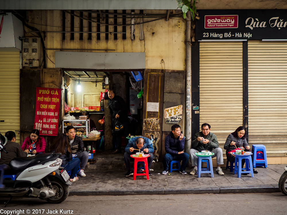 """22 DECEMBER 2017 - HANOI, VIETNAM: A """"pho"""" shop in the old quarter of Hanoi. The old quarter is the heart of Hanoi, with narrow streets and lots of small shops but it's being """"gentrified"""" because of tourism and some of the shops are being turned into hotels and cafes for tourists and wealthy Vietnamese.    PHOTO BY JACK KURTZ"""
