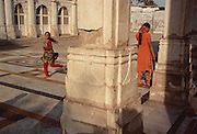"""Children play at the Sarkhej Roza, a famouse sight on the outskirts of Ahmedabad, Gujarat is an example of the early Islamic architectural culture of the region, which fused Islamic stylistic influences from Persia with indigenous Hindu and Jain features to form a composite """"Indo-Saracenic"""" architectural style."""