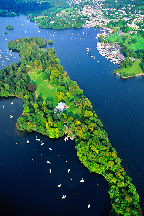 Lake Windermere in the Lake District National Park, Cumbria, England. Aerial over Belle Isle to the town of Bowness.