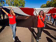 "11 NOVEMBER 2013 - PHOENIX, AZ: High school students carry an American flag at the Phoenix Veterans Day parade. The Phoenix Veterans Day Parade is one of the largest in the United States. Thousands of people line the 3.5 mile parade route and more than 85 units participate in the parade. The theme of this year's parade is ""saluting America's veterans.""    PHOTO BY JACK KURTZ"