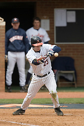 Virginia Cavaliers infielder David Adams (23) lays down a bunt against Duke.  The Virginia Cavaliers Baseball team defeated the Duke Blue Devils 8-1 in the final game of a three game series at Davenport Field in Charlottesville, VA on April 8, 2007. The win secured a 2-1 series victory over the Blue Devils.