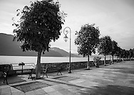 A tree-lined, lakeside promenade in the village of Cannobio in the northern Italian region of Piedmonte. The village lies along the shore of Lake Maggiore.