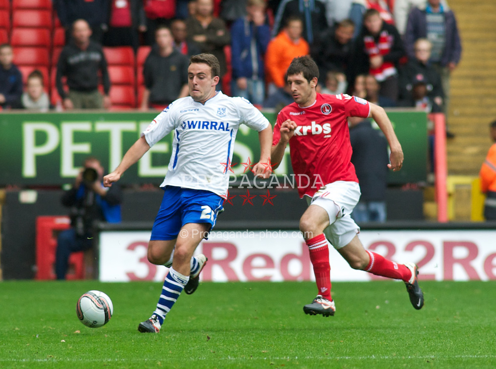 LONDON, ENGLAND - Saturday, October 8, 2011: Tranmere Rovers' Jose Baxter and Charlton Athletic's Yann Kermorgant during the Football League One match at The Valley. (Pic by Gareth Davies/Propaganda)