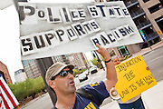 15 JULY 2010 - PHOENIX, AZ: Morpheus Titania demonstrates against SB 1070 in front of the courthouse. Titania said he was opposed to the law because it would lead to government intrusion into the lives of citizens. He was surrounded by supporters of 1070. People for and against SB 1070 picketed the front of the Sandra Day O'Connor US Courthouse (CQ) in Phoenix Thursday morning during the first hearing against SB 1070.      PHOTO BY JACK KURTZ