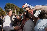 02 FEBRUARY 2004 - TUCSON, AZ: Massachusetts Senator and Democratic presidential hopeful John Kerry signs autographs and campaigns during a campaign stop in Reid Park in Tucson, AZ. PHOTO BY JACK KURTZ
