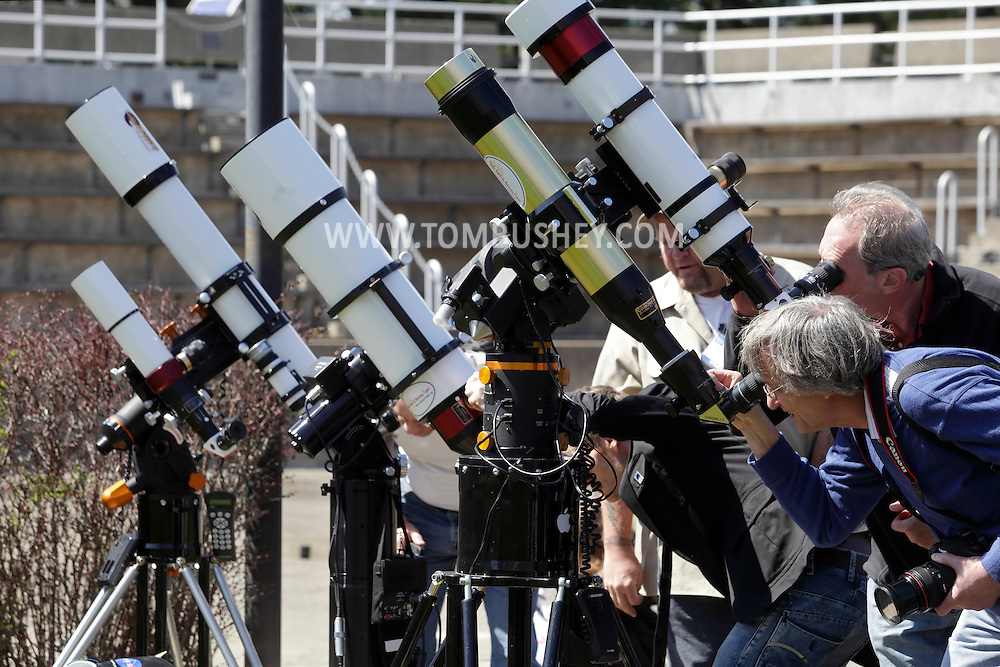 Suffern, New York - People observe the sun through solar and filtered telescopes during the Northeast Astronomy Forum and Telescope Show at Rockland Community College on April 17, 2011.