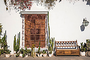 Cacti, Bougainvillea, wrought iron and woodwork in the patio at Museo Larco in Lima, Peru.