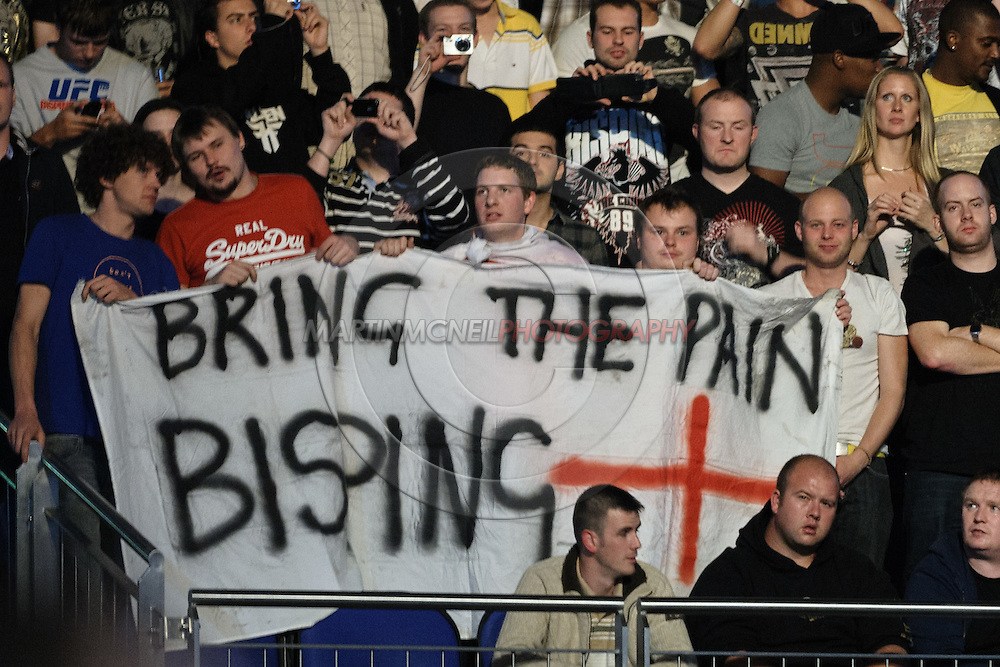 """LONDON, ENGLAND, OCTOBER 2010: Fans in the arena hold a banner in support of Michael Bisping during """"UFC 120: Bisping vs. Akiyama"""" inside the O2 Arena in Greenwich, London"""