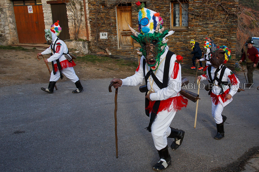 TAMAJON, SPAIN - FEBRUARY 10: People dressed as Botargas and Mascaritas take part in the Almiruete carnival on February 10, 2018 in Tamajon, Guadalajara province, Spain. The Botargas and Mascaritas of Almiruete carnival is a pagan festival. Their masks are made with items symbolizing nature, shepherding life or magic beings, like goblins or devils. They wear white clothes with colorful ornaments, sticks and hats as they walk making sounds with cowbells. At the end of the festival they throw fluff and confetti as symbol to bring fertility. (Photo by Pablo Blazquez Dominguez)