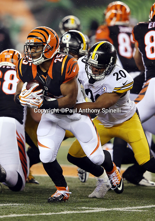 Cincinnati Bengals running back Giovani Bernard (25) gets tackled from behind by Pittsburgh Steelers strong safety Will Allen (20) on a third quarter run during the NFL AFC Wild Card playoff football game against the Pittsburgh Steelers on Saturday, Jan. 9, 2016 in Cincinnati. The Steelers won the game 18-16. (©Paul Anthony Spinelli)