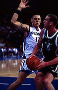 Cyril Julian contests Tony Rampton for the ball during the Men's basketball match between the New Zealand Tall Blacks and France at the Olympics in Sydney, Australia on 17 September, 2000. Photo: PHOTOSPORT<br />