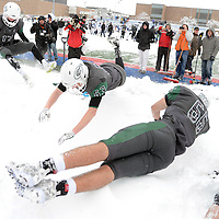 Laura Stoecker/lstoecker@dailyherald.com<br /> Glenbard West players leap into a snow back celebrating their win over Cary-Grove in the Class 7A semifinal in Glen Ellyn Saturday.