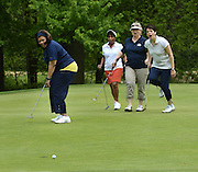 Kent State University staffers react to a putt at the Division of Diversity, Equity and Inclusion golf outing at Windmill Lakes. The event raises money for diversity scholarships through golf fees and hole sponsorships.