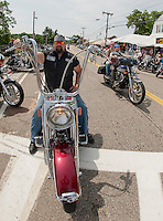Gus Pole of Connecticut stops along Lakeside Avenue on Tuesday as he takes in the sights on his third year visiting Laconia for Motorcycle Rally Week.   (Karen Bobotas/for the Laconia Daily Sun)