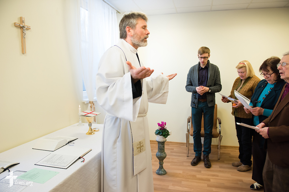 The Rev. Ivo Kirsis, a parish pastor in The Evangelical Lutheran Church of Latvia, leads Divine Service on Wednesday, Feb. 4, 2015, at a Diaconia Center mercy project site based at a municipal apartment in Riga, Latvia. LCMS Communications/Erik M. Lunsford