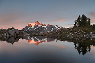 Sunset light on Mount Shuksan reflected in the tarn at Huntoon Point in the Mount Baker-Snoqualmie Forest, Washington State, USA.