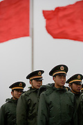 Chinese soldiers march in Tiananmen Square a day ahead of the opening of China's annual meeting of parliament, or the National People's Congress in Beijing, China, Sunday, March, 4, 2007. National People's Congress spokesman Jiang Enzhu announced Sunday that China will boost its 2007 defense budget by the most in five years, as an expanding economy gives the world's largest regular army the means to upgrade its equipment to rival Taiwan, Japan and the U.S.