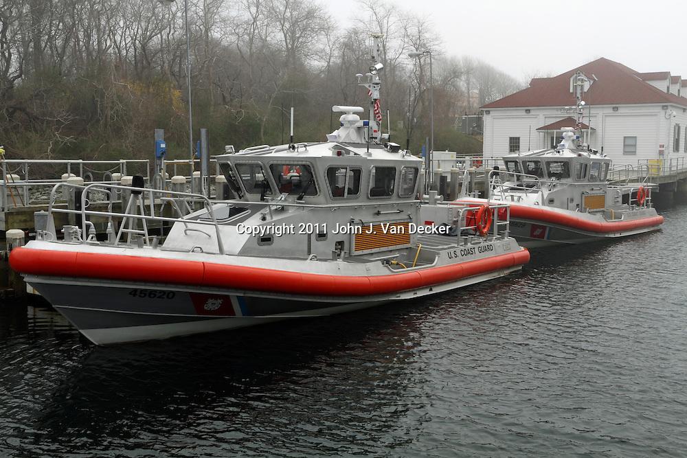 US Coast Guard boats moored on a foggy day at the Castle Hill Coast Guard Facility. Newport, Rhode Island, USA