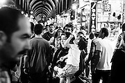 A mother with her son in one of the inner streets at Istanbul's Grand Bazaar.