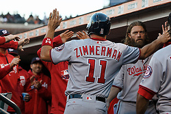 SAN FRANCISCO, CA - JULY 28: Ryan Zimmerman #11 of the Washington Nationals is congratulated by teammates in the dugout after scoring a run against the San Francisco Giants during the second inning at AT&T Park on July 28, 2016 in San Francisco, California.  (Photo by Jason O. Watson/Getty Images) *** Local Caption *** Ryan Zimmerman