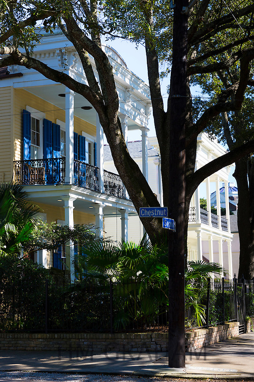 Traditional grand mansion house with wrought iron and columns in the Garden District of New Orleans, Louisiana, USA