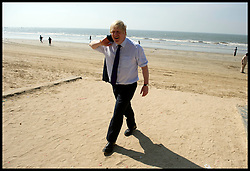 London Mayor Boris Johnson walks off the beach after playing cricket with children on Juhu beach in Mumbai, on the fifth day of his 6 day tour of India, Thursday November 29, 2012. Photo by Andrew Parsons / i-Images