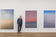 Tillmans with Transient 2, Tag/Nicht II and peninsula - Wolfgang Tillmans: 2017. Tate Modern's new exhibition. Highlights include: large scale photographic works printed especially for this exhibition, including the four-meter tall Weed 2014 and dramatic seascapes such as The State We're In, A 2015;   New 'text and table' sculptures including Time Mirrored 3 2017, on display to the public for the first time; and slide projection Book for Architects 2014. The show is at Tate Modern from 15 February to 11 June 2017.
