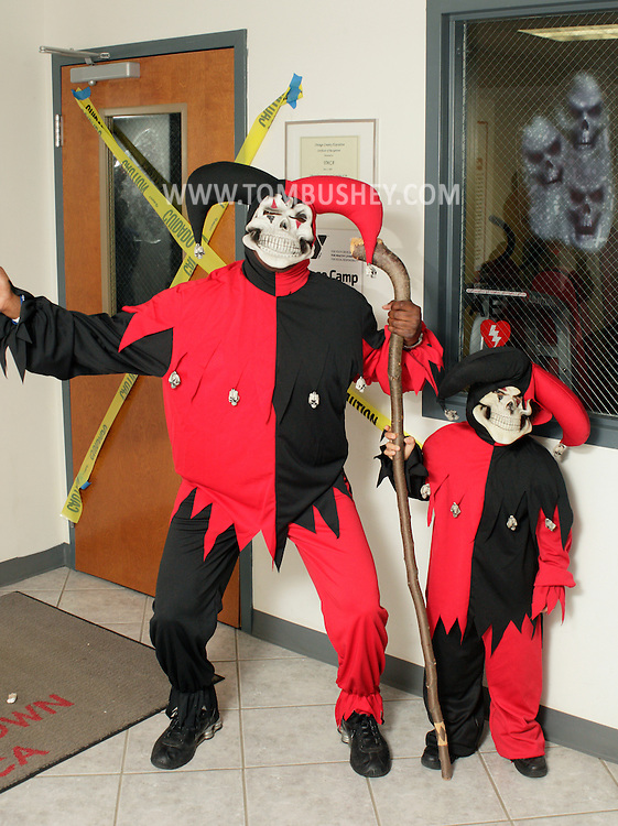Middletown, New York  - An adult and a child wearing similar costumes pose for a photograph during the Middletown YMCA Family Fall Festival on Oct. 29, 2011.