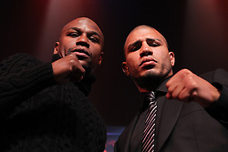 Feb 28; New York, NY, USA; Floyd Mayweather (left) and Miguel Cotto (right) pose during the press conference announcing their fight. The two will meet May 5, 2012 at the MGM Grand Garden Arena in Las Vegas, NV.