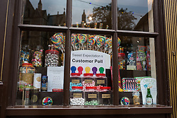 """© Licensed to London News Pictures . 17/11/2014 . Kent , UK . Shop """" Sweet Expectation """" with coloured sweets on display illustrating the voting intentions of its customers , on High Street Rochester , ahead of the Rochester and Strood by-election . Photo credit : Joel Goodman/LNP"""