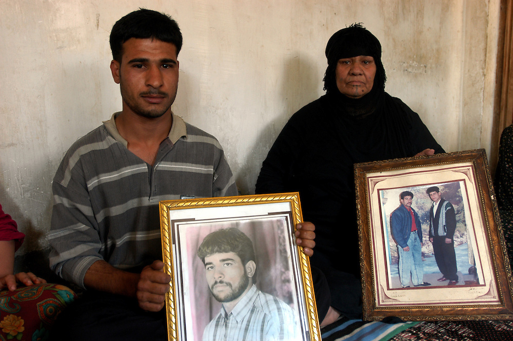 The Hadid family, originally from the Sunni area of al-Ramadi, has suffered due to it's resistance to Saddam Hussein's regime. Two sons, pictured, were arrested and executed for denouncing the regime and a third son had the end of his tongue cut off..Baghdad, Iraq. 14 May 2003..Photo © J.B. Russell / Panos
