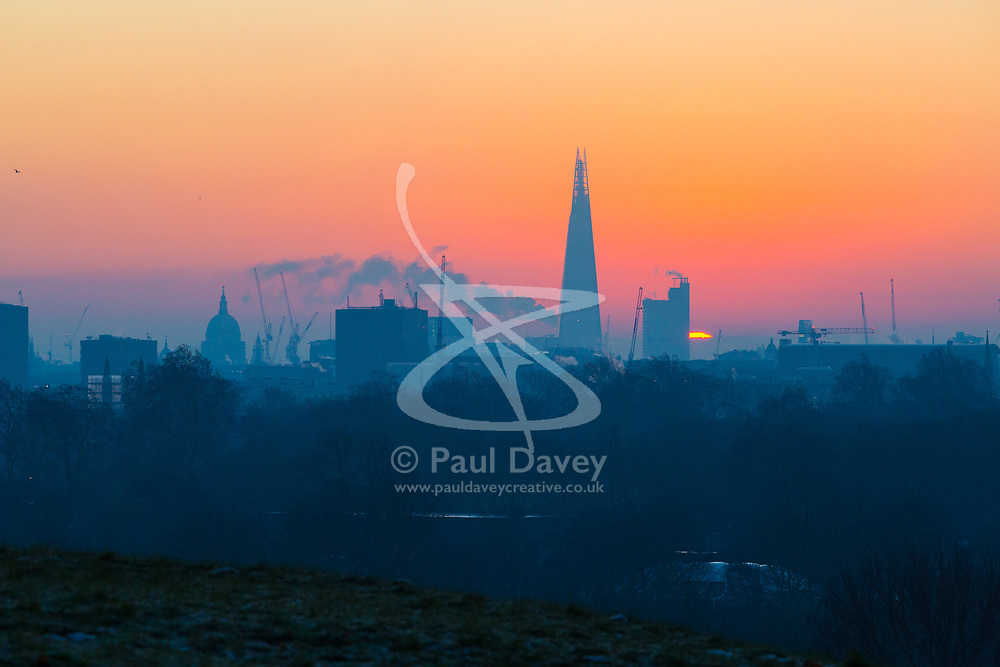 London, December 12 2017. The sun rises on a clear very cold morning in London, seen from Primrose Hill in Camden. © Paul Davey