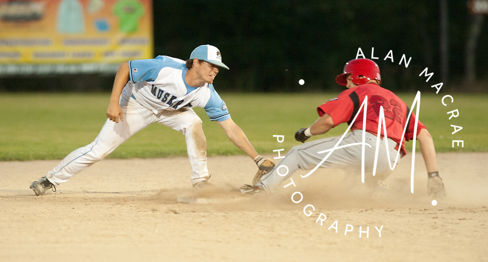Muskrats' second baseman Bryan Bass tries to tag Team Canada's Chris Robinson during Thursday's game at Robbie Mills Memorial Sports Complex.  (Alan MacRae/for the Citizen)