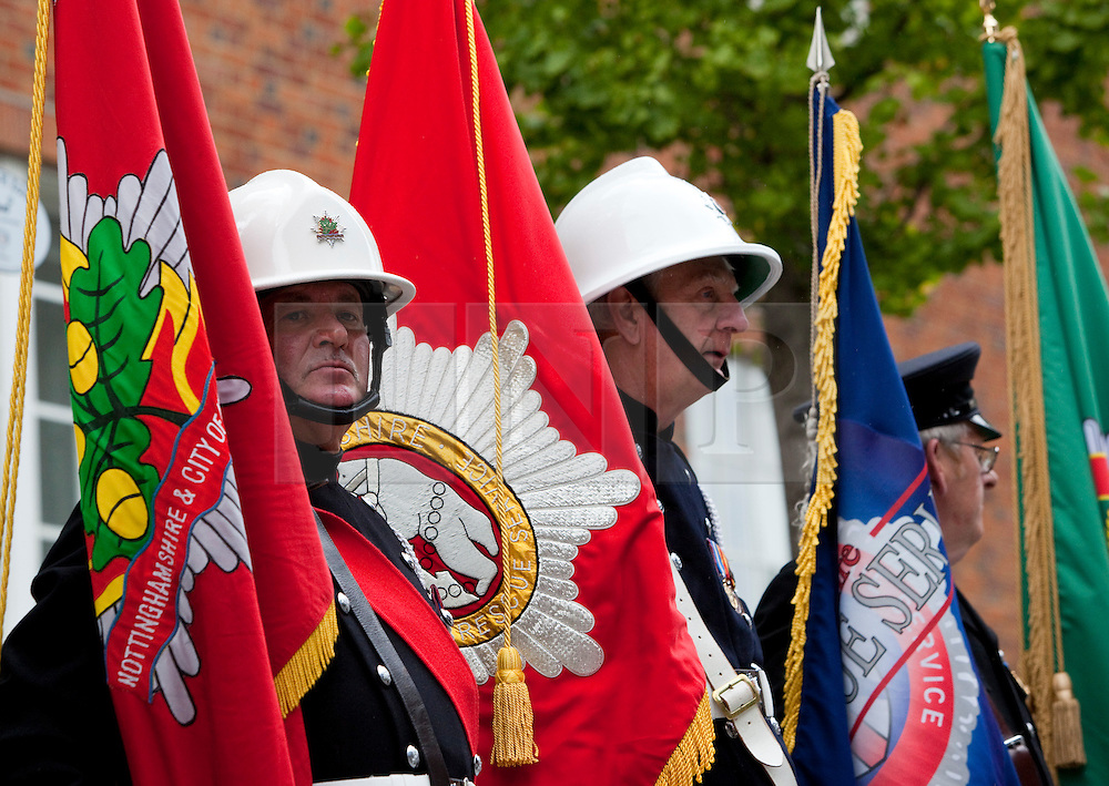 © Licensed to London News Pictures. 11/09/2011. London, UK. Around 40 firefighters bearing standards marked the event. The London Fire Brigade and the Firefighters' Memorial Trust marked the tenth anniversary of the September 11th terror attacks with a wreath-laying ceremony at the Firefighters' National Memorial in Peter's Hill near St. Paul's Cathedral. This event also marked the 20th anniversary of the Firefighters' Memorial Trust. Photo credit: Bettina Strenske/LNP