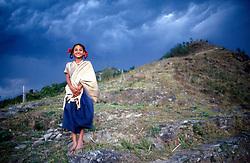 NEPAL POKHARA APR95 - A Nepalese girl hugs her blanket prior to a hailstorm brewing up in the background.<br /> <br /> jre/Photo by Jiri Rezac<br /> <br /> © Jiri Rezac 1995<br /> <br /> Tel: +44 (0) 7050 110 417<br /> Email: info@jirirezac.com<br /> Web: www.jirirezac.com