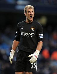 Joe Hart shows his frustration after Arsenal score their second goal during the Barclays Premier League match between Manchester City and Arsenal at City of Manchester Stadium on October 24, 2010 in Manchester, England.