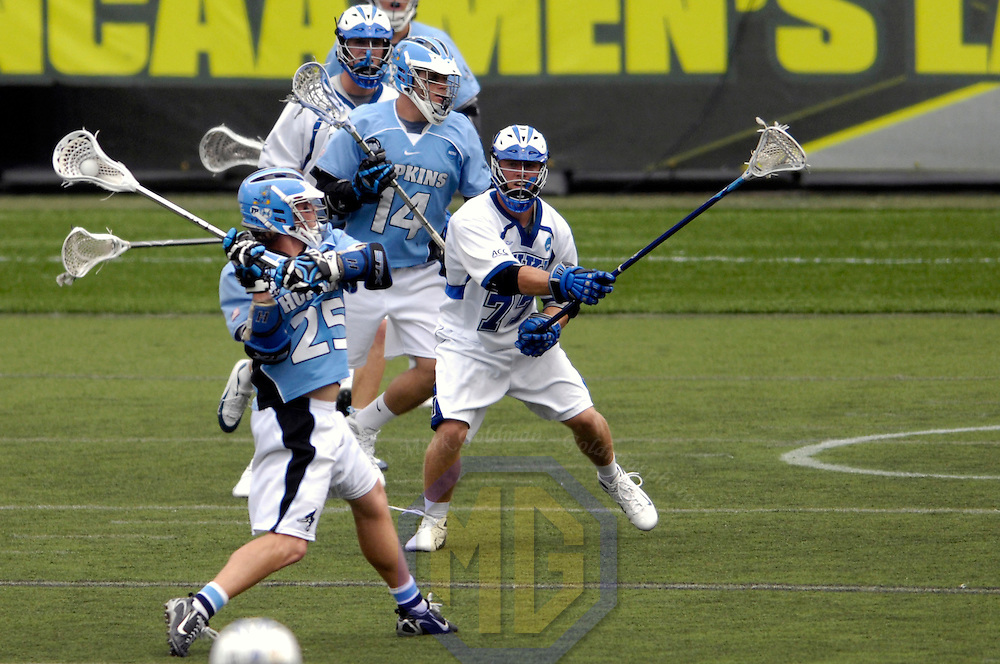 28 May 2007:  Johns Hopkins attacker Jake Byrne (25) shoots and scores a 2nd quarter goal against Duke University defenseman Nick O'Hara (77) in the NCAA Division I Lacrosse Championship game.  Byrne had 4 goals on the day as the the Johns Hopkins Blue Jays defeated the Duke Blue Devils 12-11 to win the NCAA Division I Lacrosse championship at M&T Bank Stadium in Baltimore, Md. .