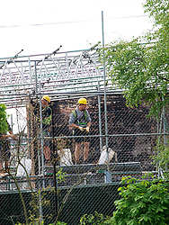 Muswell Hill Islamic Center.<br /> Workmen fix some of the damage from a fire on Wednesday June 5, 2013, which was termed suspicious by the police, in the Muswell Hill, Islamic center, <br /> London, United Kingdom<br /> Friday, 7th June 2013<br /> Picture by Max Nash / i-Images