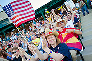 """May 29 - TEMPE, AZ: People cheer at an anti-immigration rally in Tempe, AZ, Saturday evening. About 3,000 people attended a """"Buy Cott Arizona"""" rally at Tempe Diablo Stadium in Tempe, AZ Saturday night. The rally was organized by members of the Arizona Tea Party movement to show support for Arizona law SB1070. The """"Buy Cott"""" is a reaction to the economic boycott planned by opponents of SB1070. SB1070 makes it an Arizona state crime to be in the US illegally and requires that immigrants carry papers with them at all times and present to law enforcement when asked to. Critics of the law say it will lead to racial profiling, harassment of Hispanics and usurps the federal role in immigration enforcement. Supporters of the law say it merely brings Arizona law into line with existing federal laws.  Photo by Jack Kurtz"""
