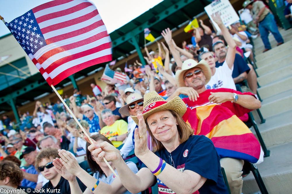 "May 29 - TEMPE, AZ: People cheer at an anti-immigration rally in Tempe, AZ, Saturday evening. About 3,000 people attended a ""Buy Cott Arizona"" rally at Tempe Diablo Stadium in Tempe, AZ Saturday night. The rally was organized by members of the Arizona Tea Party movement to show support for Arizona law SB1070. The ""Buy Cott"" is a reaction to the economic boycott planned by opponents of SB1070. SB1070 makes it an Arizona state crime to be in the US illegally and requires that immigrants carry papers with them at all times and present to law enforcement when asked to. Critics of the law say it will lead to racial profiling, harassment of Hispanics and usurps the federal role in immigration enforcement. Supporters of the law say it merely brings Arizona law into line with existing federal laws.  Photo by Jack Kurtz"