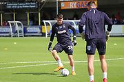 AFC Wimbledon goalkeeper Joe McDonnell (24) and AFC Wimbledon goalkeeper Tom King (1) warming up during the EFL Sky Bet League 1 match between AFC Wimbledon and Sunderland at the Cherry Red Records Stadium, Kingston, England on 25 August 2018.