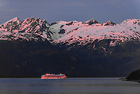 """Norwegian Cruise Line ship """"Norwegian Sun"""" sailing up the Lynn Canal (the deepest fjord in North America), passing Haines, en route to Skagway, Inside Passage, Southeast Alaska USA."""