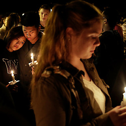 Students and community members attend a vigil at the Grove Church after a shooting at Marysville-Pilchuck High School in Marysville, Washington October 24, 2014. A student fatally shot one classmate and wounded four others when he opened fire in the cafeteria of his Washington state high school on Friday, following a fight with fellow students, authorities said. The shooter took his own life as Marysville-Pilchuck High School students scrambled to safety in the latest outburst of deadly violence at an American school. REUTERS/Jason Redmond   (UNITED STATES)