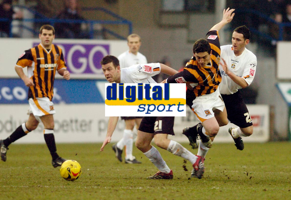 Photo: Leigh Quinnell.<br /> Luton Town v Hull City. Coca Cola Championship. 04/02/2006. Hulls Keith Andrews gets between Lutons Keith Keane and David Bell.