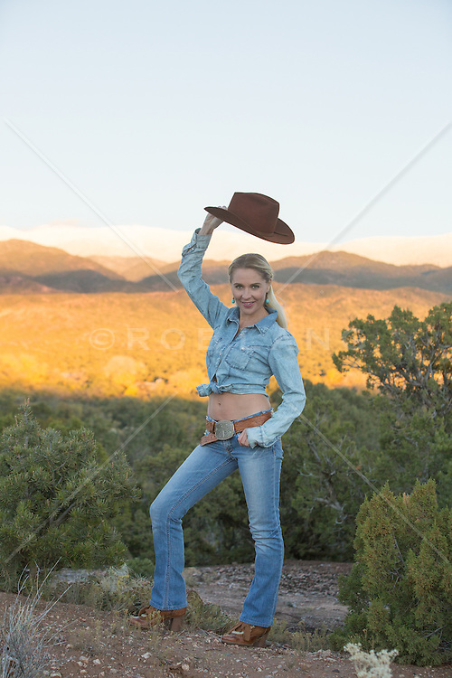 woman with a cowboy hat outdoors